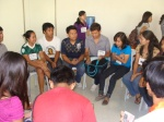West Visayas State University delegates in a caucus session to plan for the anti-budget cut campaign in their school.