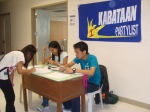 Kabataan Partylist-Panay members man the registration for the summit.